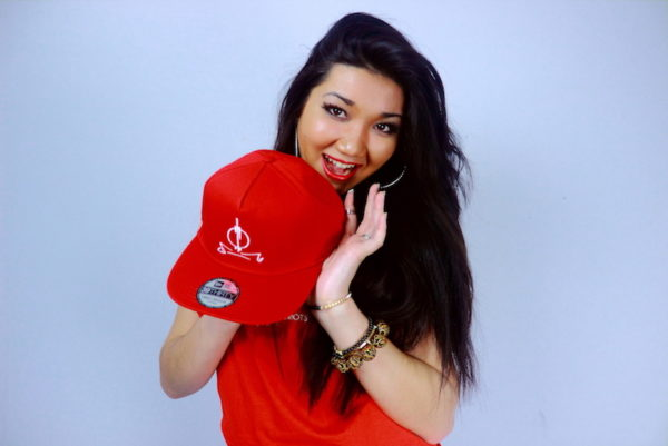 Jivanah holding Original RED SND Series Cap